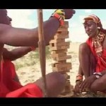 Massai Warriors Playing Monkey Pod Games Tumbling Tower